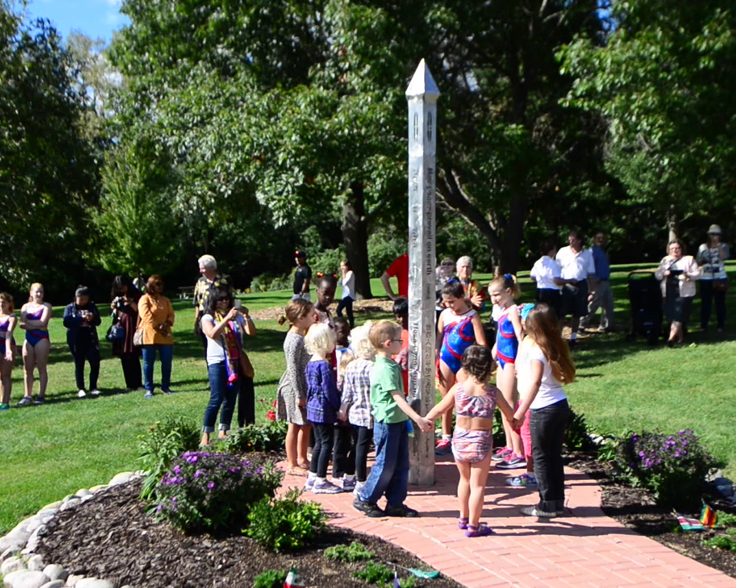 Kids around peace pole